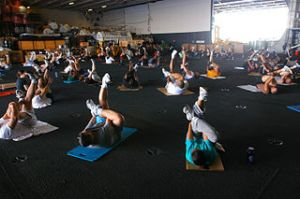 US_Navy_070409-N-1525H-006_Crew_members_participate_in_a_daily_workout_routine_in_the_hangar_bay_aboard_the_nuclear-powered_aircraft_carrier_USS_Nimitz_(CVN_68)